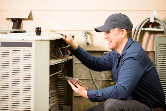 Repairmen works on a home's air conditioner